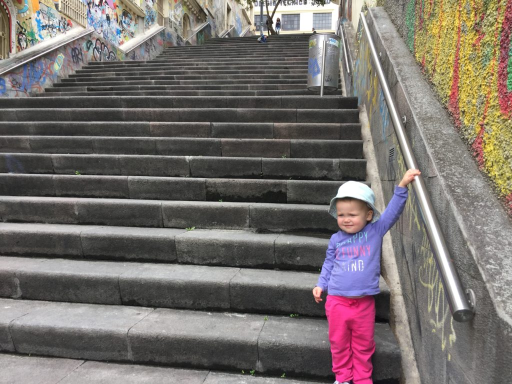 Preparing for the trek up the stairs we use on our way home from the kids' Ecuador school. Marcella insists on doing them all on her own.