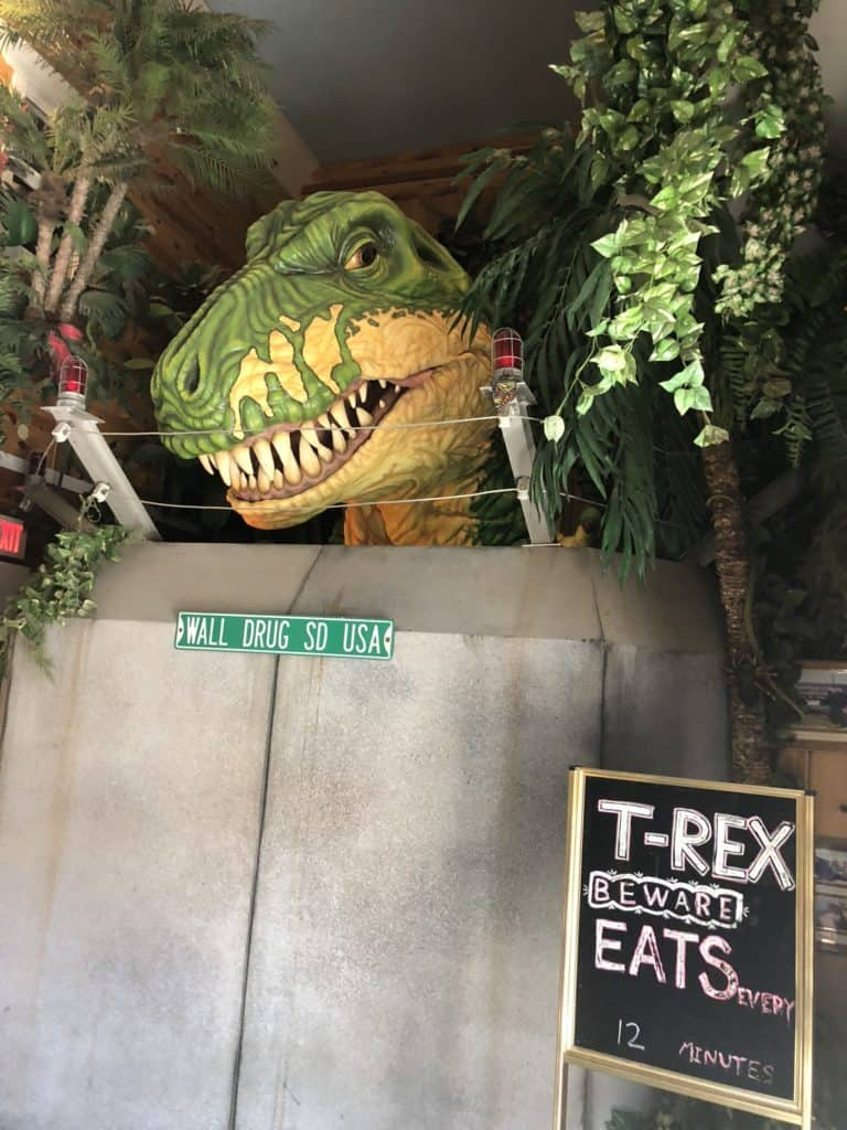 "About 5 seconds after we walked up to him, this guy started spewing steam, moving, blinking, and roaring. The kids were terrified and we spent the next two days talking about how the ""robot T-Rex"" was not real."